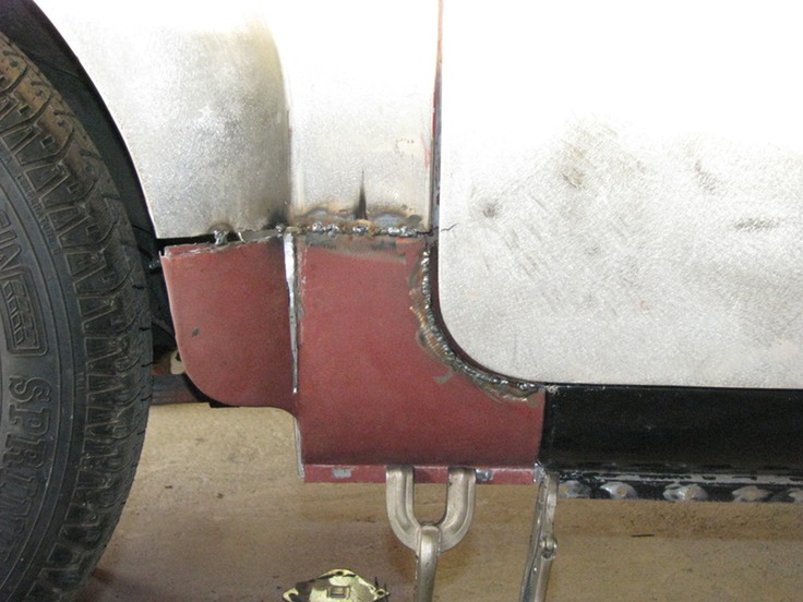Significant reshaping was required to make the new patch panels match the original rear fenders. The door is slightly ajar in this picture which makes the ... & Door Gap   Bradley Restoration